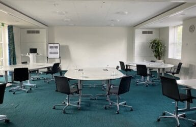 Picture of a social distancing set up meeting room at Moller Institute