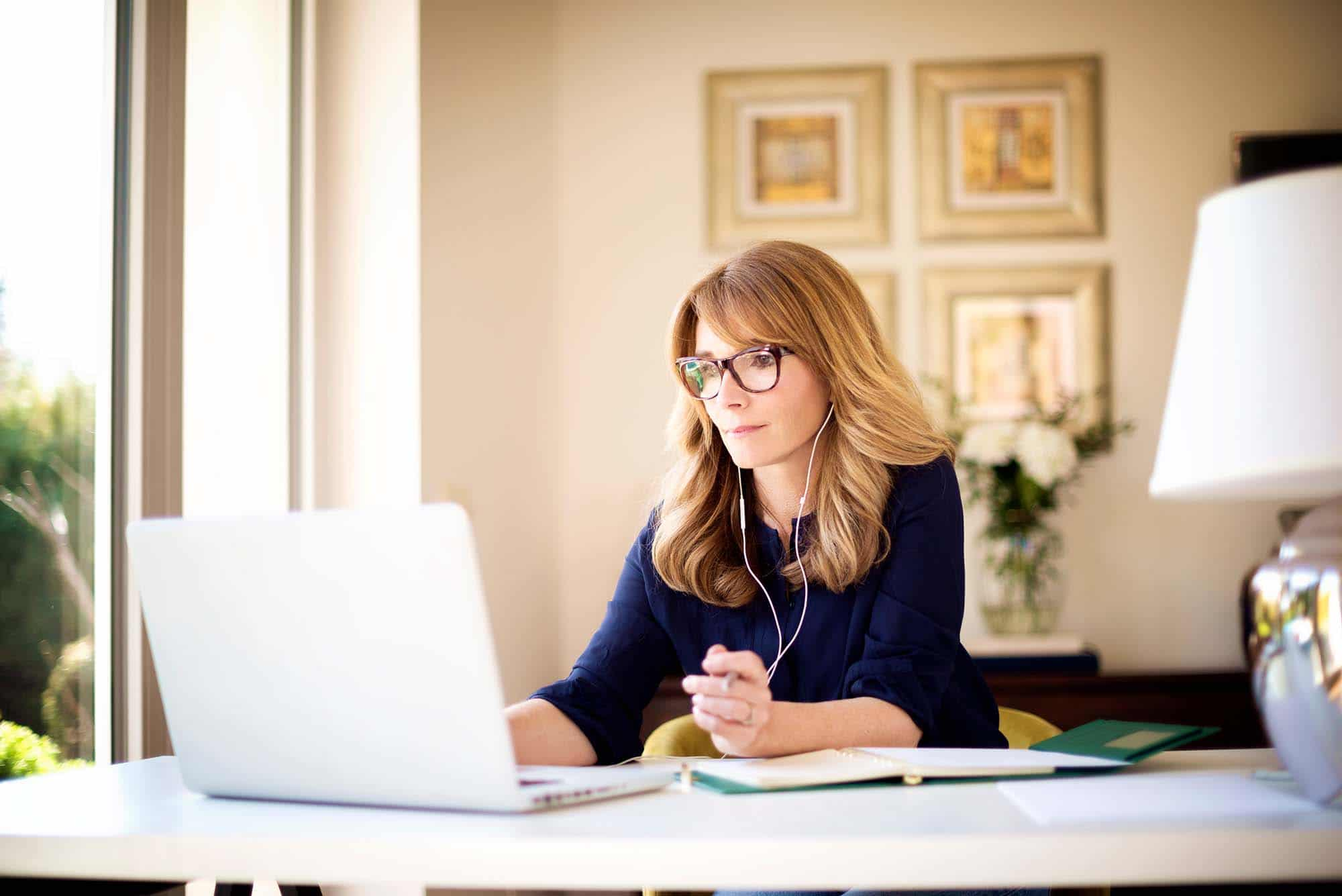 Picture of women with glasses on laptop