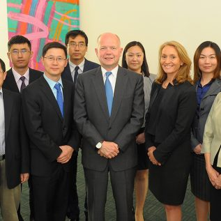 Picture of William Hague with delegates at the Møller Centre